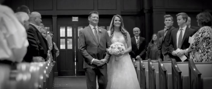 Dr. Gorman walking his daughter down the aisle on her wedding day