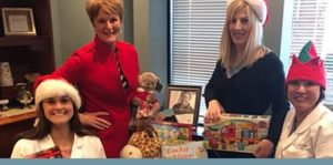 The team of The Gorman Center for Fine Dentistry donating toys for Toys for Tots