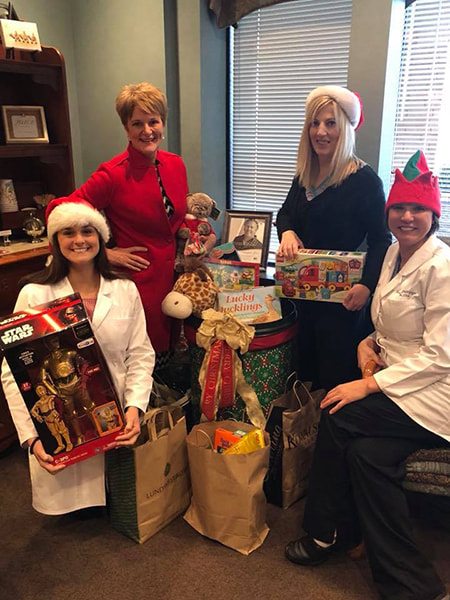 Your North Oaks dental team giving back by donating toys for Toys for Tots