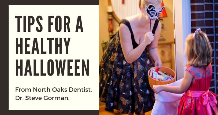 "A woman handing out candy to a trick-or-treater with the text ""Tips for a health Halloween from North Oaks Dentist, Dr. Steve Gorman"