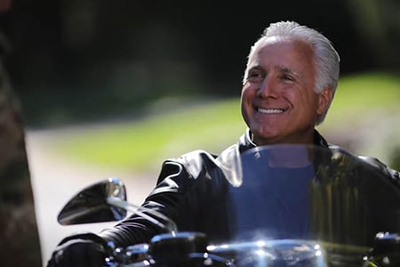 Real patient, Paul, on his motorcycle outside